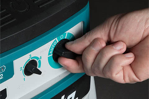 Picture of activation button on dust extractor